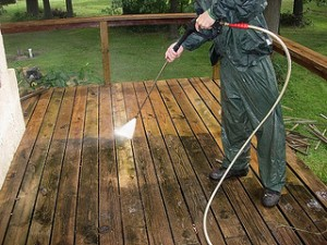 Pressure washing deck removing dirt